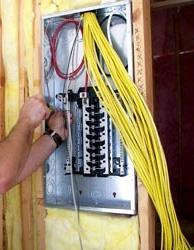 A person working on an electric box.