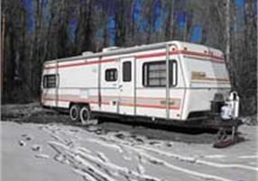 Parked bumper pull RV with snow on the ground