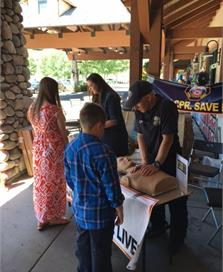 EMTs Teaching CPR to Kids